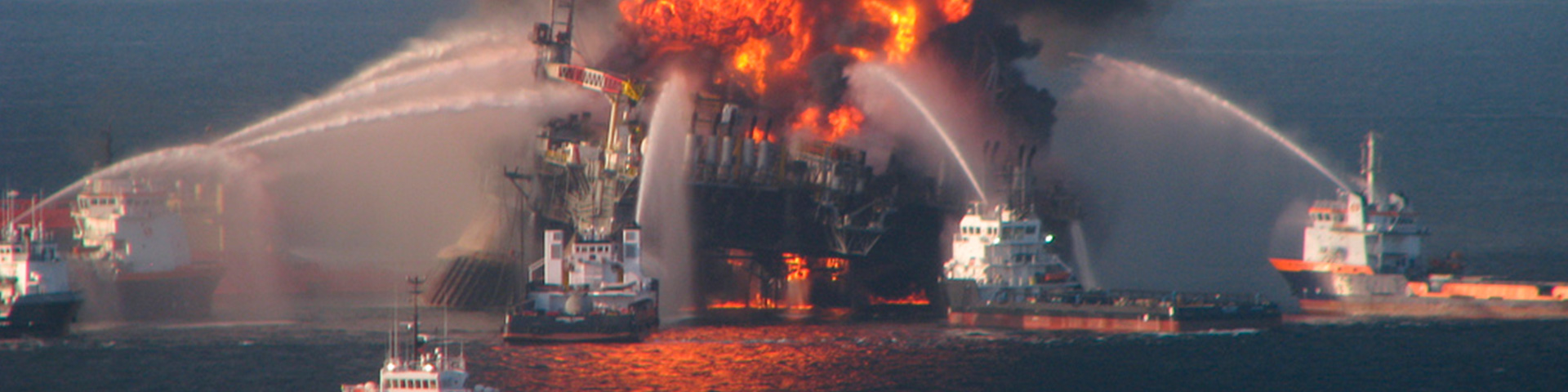 An ablaze oil rig being put out