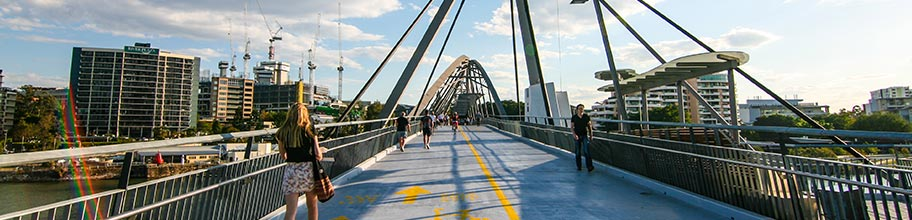 Cyclists and pedestrians using the Goodwill green bridge in Brisbane CBD