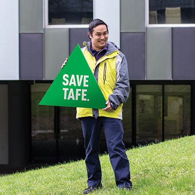 Image of person with a Greens sign