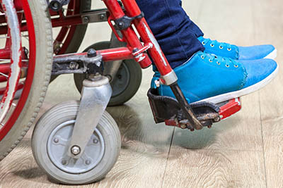 A person in a wheelchair.