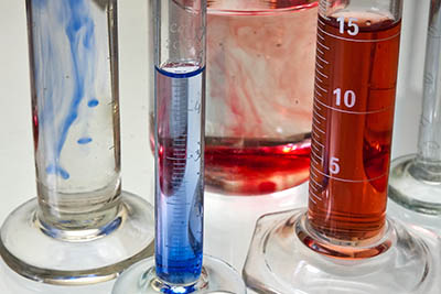 Transparent chemistry glass tubes filled with substances.