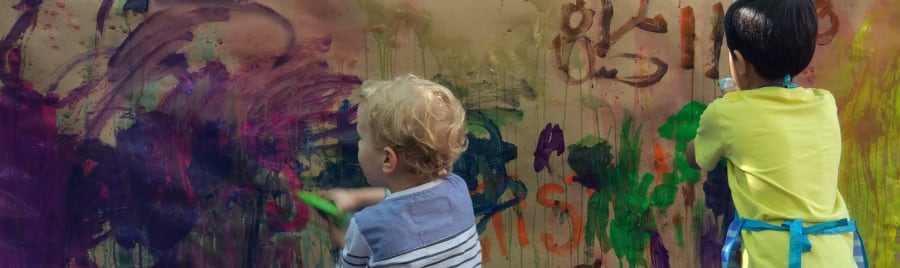 two kids painting at a childcare centre
