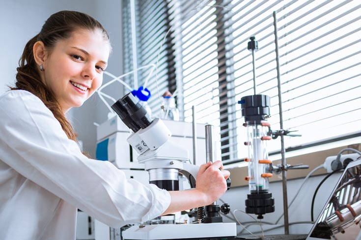 Female scientists at microscope