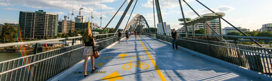 Cyclists and pedestrians cross the Goodwill bridge in Brisbane