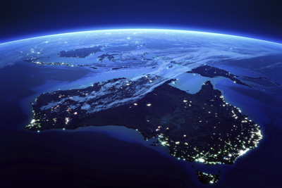 Image of Australia viewed from above at night — lots of electric lights
