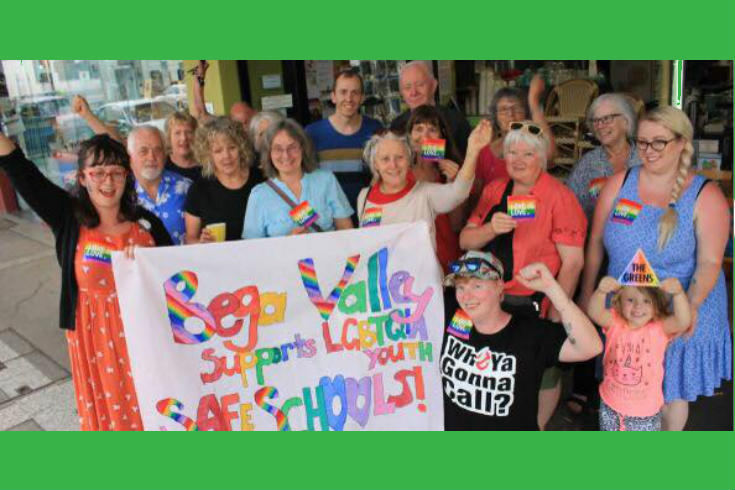 "Bega Valley Greens members with a poster reading ""Bega Valley supports LGBTQIA youth - Safe Schools!"""