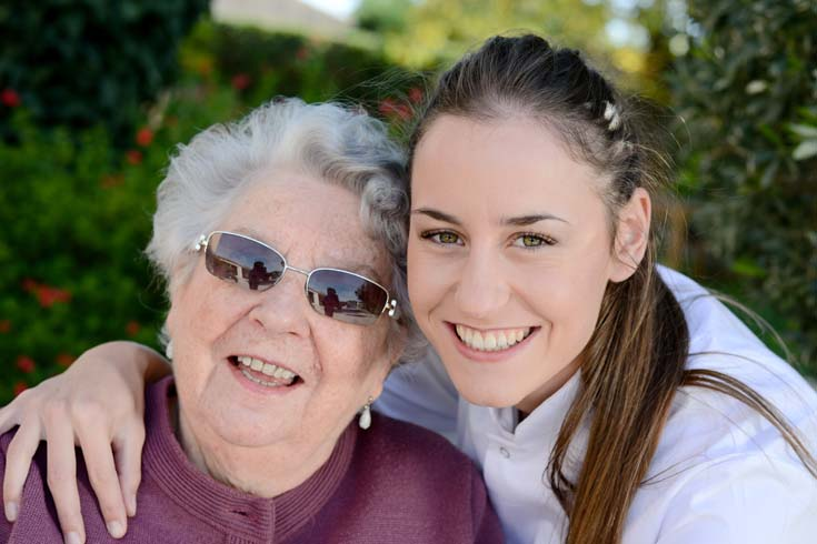 Young carer with elderly woman