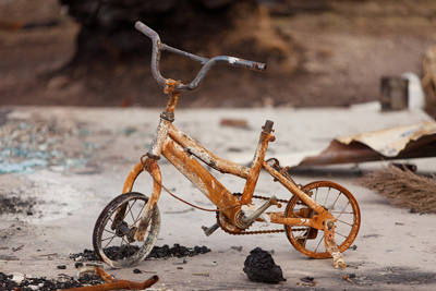 A child's tricycle, burnt by fire