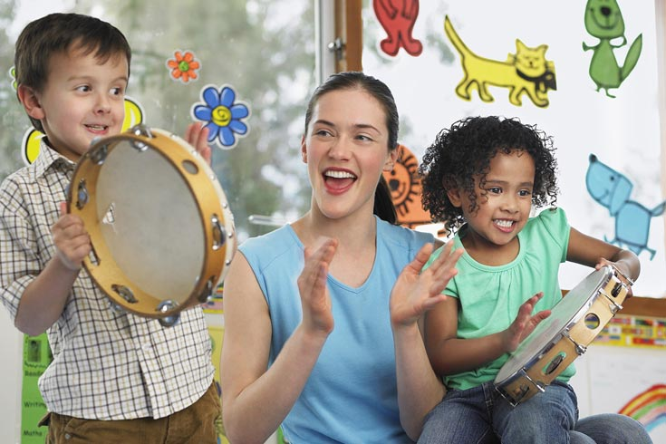 Children play music with a teacher
