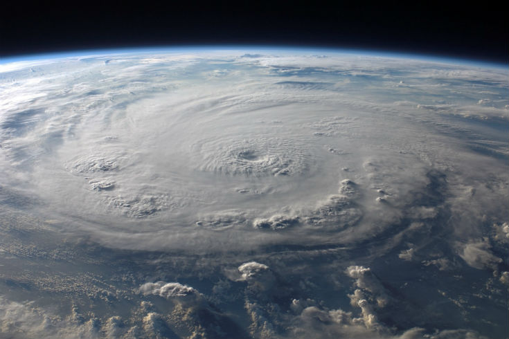 View of Earth from space, looking at the formation of a hurricane in the upper atmosphere