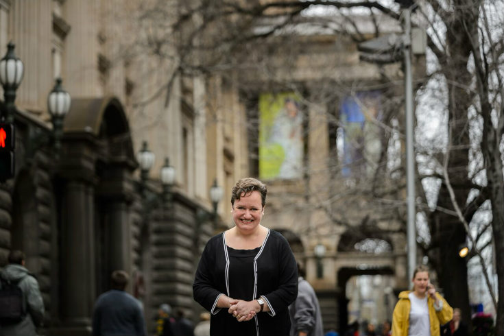 Dr Olivia Ball standing on a busy Melbourne street