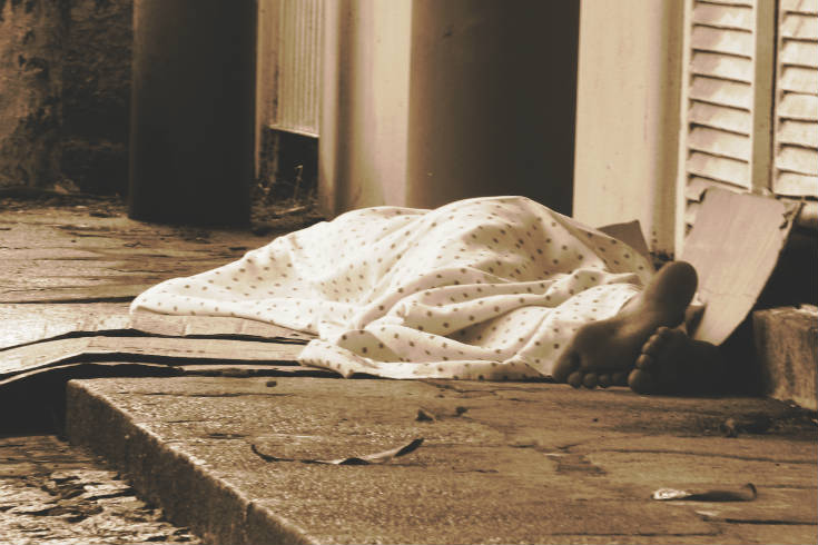 Homeless person sleeping on the street