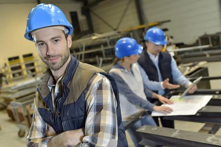 Portrait of cheerful industrial engineer