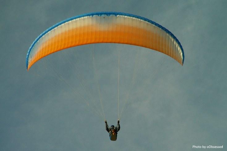 Mental Health, a person in a rainbow parachute