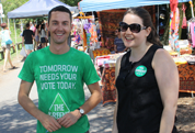 Volunteers in Brisbane wearing Greens T-shirt and buttons