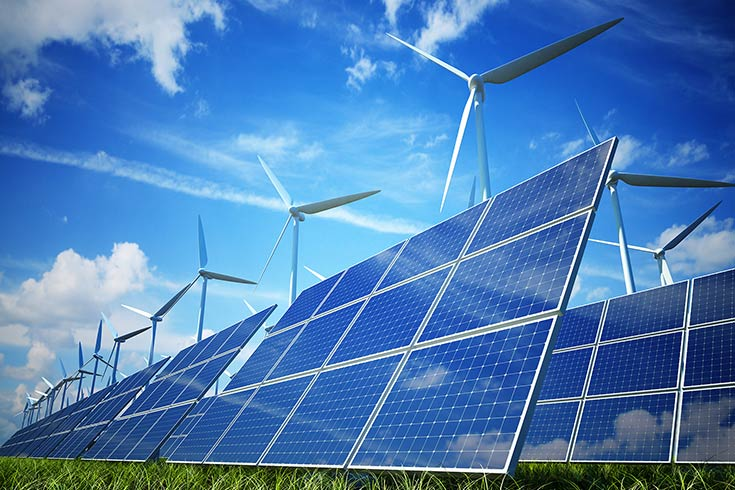 Image of solar panels and wind turbines on a sunny day