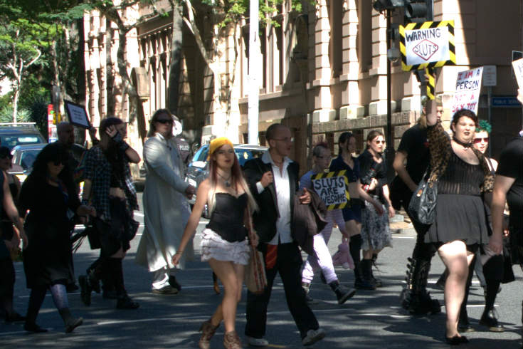 People marching with protest signs at Slutwalk Brisbane in 2012