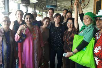 A group of smiling women from the Asia Pacific Greens Tour 2016