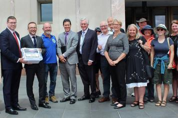 MPs accept a climate emergency petition in the APH forecourt
