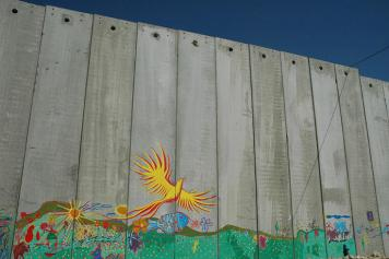 Mural on the Israeli West Bank Barrier. Picture taken by Justin McIntosh, August 2004.