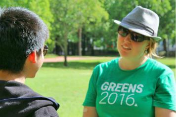 ACT Greens volunteer in a one-on-one conversation