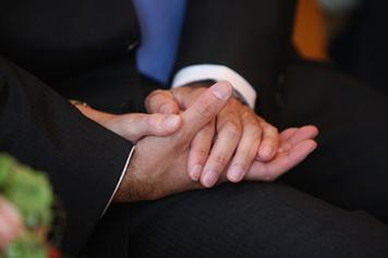 Holding hands at a wedding