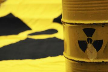 Yellow container with radioactive symbol