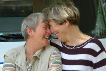 two older people laughing intimately