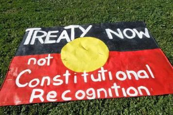 Treaty now, not constitutional recognition: banner on Aboriginal Flag