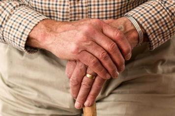 Old man holding walking stick