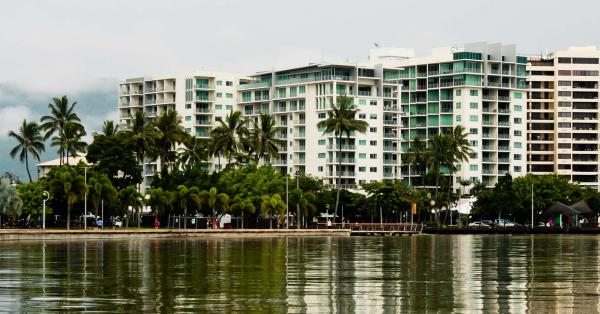 Buildings reflected in the waterfront of Cairns, Queensland.