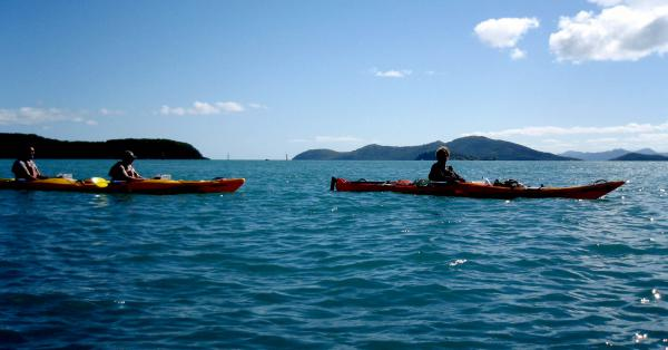 Two kiyaks paddling in the Whitsundays, Queensland.
