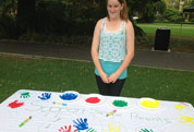 Girl at Perth Single Parents' rally with handprints