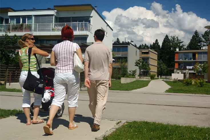people walking through new development